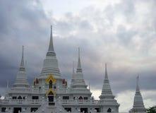 Black rain cloud over white Chedi. Of Wat Asokaram ,  Samutprakarn, Thailand Stock Photography