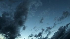 Black rain clouds moving rapidly across the sky In the evening.  stock footage