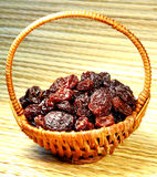 Black raisin in wicker basket Stock Photos