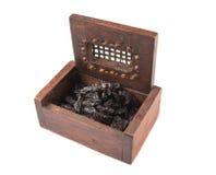 Black Raisin In Wooden Box III Stock Photo