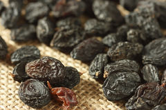 Black Raisins. Close up view of Black Raisins. Raisins are dried grapes. They are produced in many regions of the world including India Stock Image