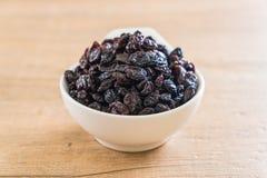 black raisins in bowl Stock Image