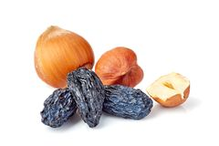 Black raisins and hazelnuts on white. Black raisins and hazelnuts izolated on white background royalty free stock photo
