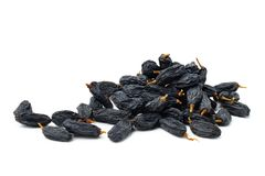 Black raisins on white background. Isolated Stock Image