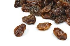 Black raisins on a white background Royalty Free Stock Image