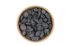 Black raisins in a wooden bowl Royalty Free Stock Images