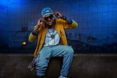 Black rapper in underpass, grunge subway