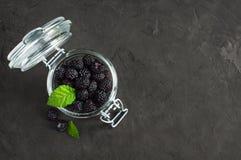 Black raspberry or blackberry in glass jar Stock Images