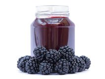 Black Raspberry Jam. In jar with fruit on white background Stock Photos
