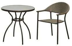 Black rattan round table and Rattan leisure chair on a white background stock photos