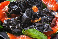 Black ravioli with salted salmon Stock Photography