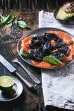 Black ravioli with salted salmon Royalty Free Stock Photo