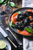 Black ravioli with salted salmon Royalty Free Stock Images