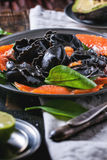 Black ravioli with salted salmon Royalty Free Stock Image