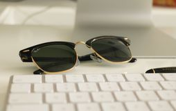 Black Ray-ban Clubmaster Sunglasses on White Surface Royalty Free Stock Photos