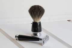 Black razor and shaving brush Royalty Free Stock Photos