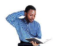 Black reading a book. royalty free stock image