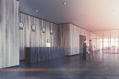 Black reception desk, light wooden office, people Royalty Free Stock Images