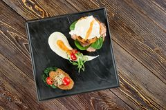 Black rectangle plate with food, top view. Three types of food on rectangle plate Stock Images