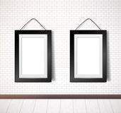 Black rectangular frame hanging on white brick wall royalty free illustration