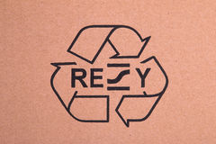 Black recycle symbol on cardboard Royalty Free Stock Images