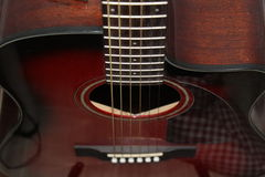Black Red Acoustic Guitar Closeup Stock Photography