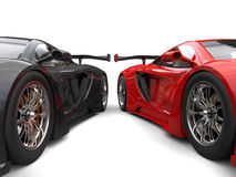 Black and red awesome supercars side by side - wheels closeup shot Royalty Free Stock Photos