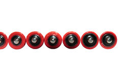 Black and red batteries in a row on white Royalty Free Stock Images