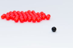 Black and red bead on white background Stock Photography