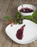 Black and red blackberries with jam Stock Image