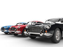 Black, red and blue classic vintage cars in a row Stock Image