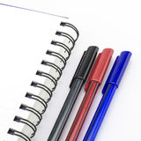 Black red and blue pen with notebook isolated on white. Background Stock Photo