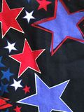 Black red blue stars black background Stock Photography