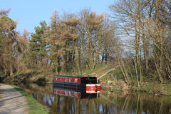 Black and red canal boat on Lancaster canal Stock Images