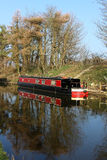 Black and red canal boat on Lancaster canal Royalty Free Stock Photos