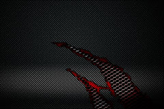 Black and red carbon fiber tear on the red metallic mesh. Background and texture. 3d illustration royalty free illustration