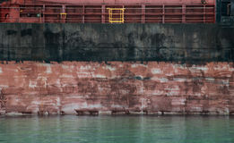 Black and red cargo ship hull side texture Stock Images