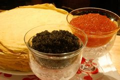 Black and Red Caviar. With pancakes Stock Photos