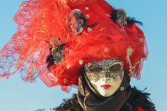 Black and red costumed masked woman portrait. At San Giorgio in Venice Stock Image