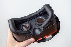 3D virtual reality headset in a hand with a white background royalty free stock photography