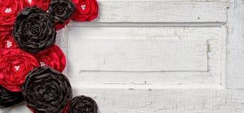 Black and Red flowers on vintage door. Black and Red shabby chic flowers on vintage door Stock Photography