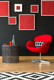 Black and red furniture. And wall full of frames stock photos