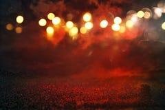 Black and red glitter lights background. defocused Stock Image