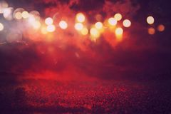 Black and red glitter lights background. defocused Royalty Free Stock Photo