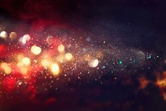 Black and red glitter lights background. defocused Royalty Free Stock Photos
