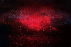 Black and red glitter lights background. defocused Royalty Free Stock Images