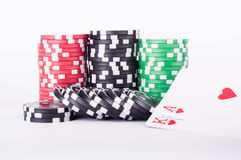 Black, red and green casino chips isolated on white Stock Photo