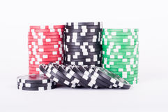 Black, red and green casino chips isolated on white Royalty Free Stock Image