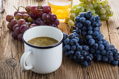 Black, red and green grapes and freshly squeezed grape juice Stock Image