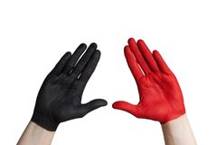 A black and a red hand stock image